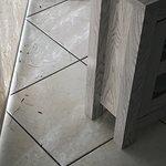 Dirty floor behind tv by sliding glass door.