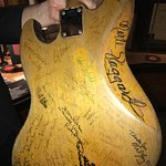 Signatures of Stars on back of studio musician's guitar