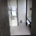 Master bath with full closets besides bedroom