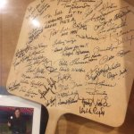 I may have never seen an autographed pizza paddle before