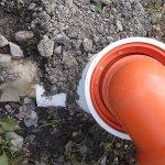 Sewage leaking onto ground/ broken pipe