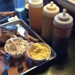 Ribs, Cold Slaw and Gits. The three bottles of BBQ sauces.