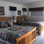 Den 1 queen pillow top beds, room darkening shades added 2017