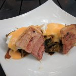 Pork bellies with hollandaise and collard greens