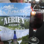 Glass of sangria and menu
