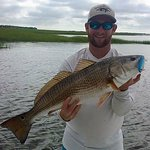 Over slot red drum caught on a topwater plug