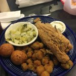 Whole catfish with cabbage and fried okra.