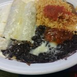Shredded beef enchiladas, no red sauce, cheese on top, rice and black beans with salsa