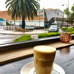 sit at our window bench and watch the world go by with a coffee