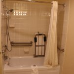 Soap dishes and grab bars at different levels. Note also, the shower bench. Great design!