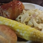 Stuffed cabbagen noodles and cabbage corn and a roll. Also has a salad bar.