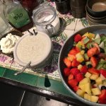 Warm made rice pudding and delicious fruit