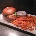 Cajun chicken and garlic mayo burger with sweet potato fries