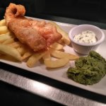 Beer battered fish and chips with mint and creme fraiche pea puree