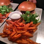 Lamb and mint burger in brioche bun with tzatziki and sweet potato fries