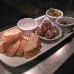 Sharing starter of minted lamb balls, olives, tzatziki, and breads
