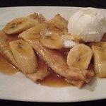 Fresh homemade pancakes, bananas, hot toffee sauce and icecream