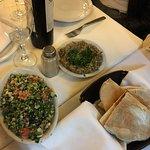 Delicious food with a great atmosphere. baba ganoosh, tabooleh salad, warm pita, and lamb kafka