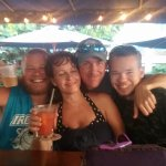 The front bar with my 2 sons and our favorite bartender, Derek. He really made it so much funner