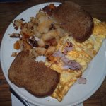 omelet with toast and potatoes
