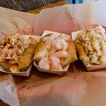 Trio: one half each of a lobster roll, crab roll, and shrimp roll