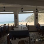 The view from inside the restaurant onto the beach.
