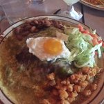 Blue corn enchiladas with a fried egg on top
