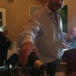 Chef/owner, Louis Moskow, pouring champagne for us.