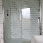 Huge shower, two shower heads (rainshower/reg) and ledge for shampoo!