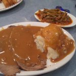 Roast beef, mashed potatoes, gravy and string beans