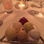 Generous assortment of sorbets and ice cream in what looks like a pool table triangle.