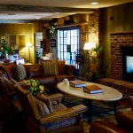 Cozy lobby with fireplace and reading area. Cheese and sherry are served each afternoon.