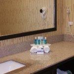 Roomy vanity with great lighting, nice amenities