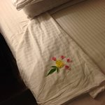 Nice touch: Stylised flower made up of real flower petals and a leaf left after the bed turndown
