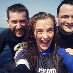Excitement with our instructor about the completed final dive