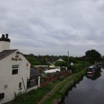 View to the Bridge Inn and out-door eating area next to the canal near Tatenhill Lock.