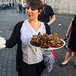 Roberta with a plate of Jewish fried artichoke, a gorgeous display of baked goods, and tiramisu