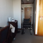 Room with wheelchair in situ to show dimensions