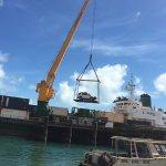 Loading a 4 wheel drive onto Trinity Bay.