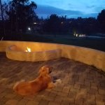 "Andy enjoying the fire pit and views at night from our patio, 1st floor ""The Greens"" building"