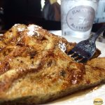 Texas Styled Cinnamon Raisin French Toast, grilled and sprinkled powdered sugar, and smothered w