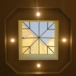 View looking up at hotel through restaurant skylight