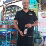Our waiter Lorro, with the tequila we ended buying later in the holiday.