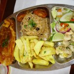 Fish, shrimps, rice with beans, salad