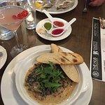 Beautiful presentation of tomahawk steak & escargots.