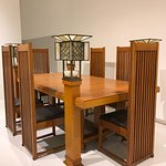 Dining suite by Frank Lloyd Wright creates intimacy as diners are hidden by chair backs + lamp p
