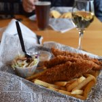 Salmon fish and chips, coleslaw, tartar, and wine