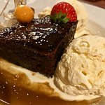Out-of-this world ginger sticky toffee pudding with vanilla ice cream.
