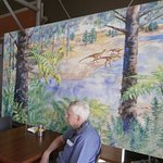 Mural of Lake at time of Dinosaurs living nearby. Cafe at Conservation Park.