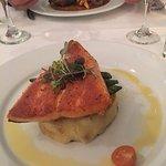 Pan Roasted Salmon Fillet With potato cake, sautéed green beans, orange beurre blanc sauce